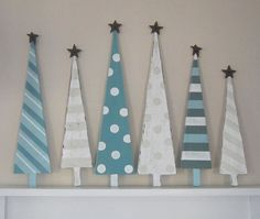 wooden Christmas trees - do this next year for above the TV.                                                                                                                                                      More