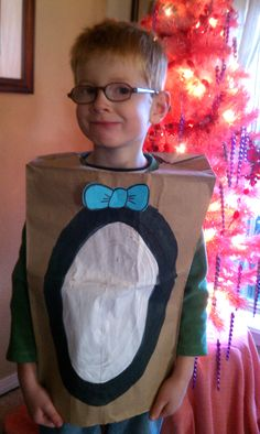 Penguin #paper_bag costume for pre-k #Arctic_animals unit.  Waddle like a penguin with an egg(ball) on your feet.