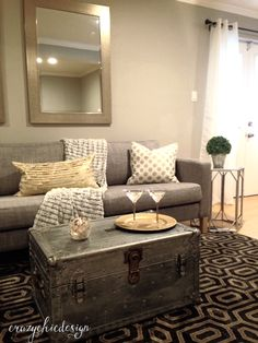 Create a modern lounge by using classic cool tones, geometric shapes, and mixed metals.  This area rug sets the perfect vintage/modern tone! The mirror, side table and pillows add the right amount of shine. All available at HomeGoods.  Sponsored Pin.
