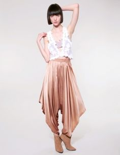 Champagne harem pants.Harem pants or harem trousers : also known as parachute pants, are women's baggy long pants tapered at the ankle, with side flaps on the hip that button at the waist area.(Felicia Marchella Blanco) FMM1B2