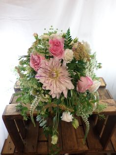 Garden, wild, cascading wedding bouquet in creams, greens and blush pinks. Designed by Florist ilene, Hamilton, NZ Cascading Wedding Bouquets, Flowers Delivered, Corsage, Gift Baskets, Hamilton, Blush Pink, Beautiful Flowers, Great Gifts, Floral Wreath