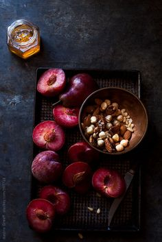 Preparing plums and pears to bake/grill and garnish with nuts and honey by Nadine Greeff