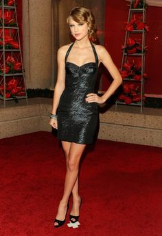 Taylor Swift in a Zac Posen dress and Christian Louboutin shoes at the 2010 BMI Country Music Awards.