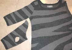 A quick photo tutorial on how to make a dog (or cat! or lizard!) sweater out of a used thrift store sweater sleeve, an old sweatshirt or other human garment made out of warm, knitted fabric..