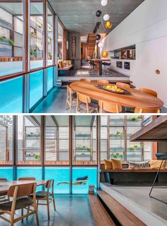 Stepping down from the kitchen to the dining area in this modern house, there are windows that for a unique view of the swimming pool.