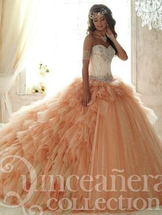 77f5bc232d2 Quinceanera Collection 26821 Sparkle tulle ruffles around the waist and  down the sides and back of this gown before opening into a shimmering  blanket of ...