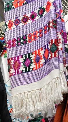 This woven cloth is the size of a bedspread or large tablecloth. It was for sale in a market in the city of Oaxaca Mexico.  The cloth appears to have been woven on the Pacific coast of Oaxaca, possibly in San Juan Colorado which is a major weaving community