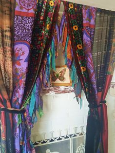 Gypsy Bohemian Curtains handmade by HippieWild- EARTH BELOW ME  ONE OF A KIND  Created with vintage textiles, and scarves, vintage velvet fabric, vtg silver metallic scarves, fringe Curtains are lined in fringe made of every beautiful bit available Fuzzy Ribbon tiebacks included  Measurements: Listing Includes (2) Panels ..Each Panel is approx 46 wide x 79 long ( 1  Rod Pocket ) Edges are raw zig zag stitched  BE HERE NOW...OHMMMMM