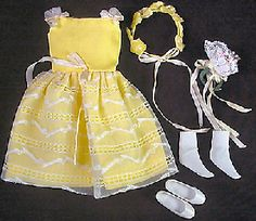 I seriously used to have this dress for my aunt's Skipper doll from the 60s... what a cute idea for a flower girl!