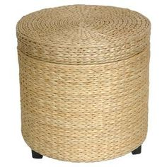 """Woven rattan storage ottoman. Product: Storage ottoman    Construction Material: Rush grass and cotton    Color: Natural     Features: Light weight, practical home accessory     Great for storage       Dimensions: 17"""" H x 17.5"""" Diameter"""
