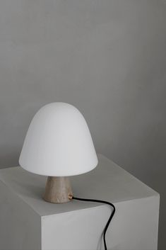 Made from solid stone, glass and brass, Meadow is a table lamp that balance materiality with light. A simple composition of a dome-shaped shade that is mirrored in the more diminutive stone base gives Meadow an organic, unassuming look. #fredericiafurniture #complementss #meadowlamp #meadow #spacecopenhagen #modernoriginals #craftedtolast #interiordesign #danishdesign #scandinaviandesign 11 Howard Hotel, A Table, Table Lamp, Space Copenhagen, Leather Box, Danish Design, Scandinavian Design, Mirror, Interior Design