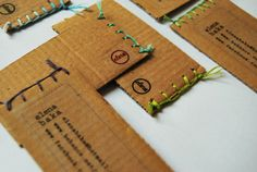 Cardboard, thread and clear printed sticker