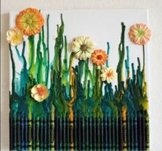 Glue some crayons onto a canvas and melt with a hair dryer. Once done, glue on some flowers to make a cute crayon garden!