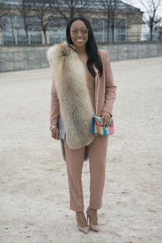 Shiona Turini in blush suit accessorized w/ a furry stole and Valentino bag #StreetStyle