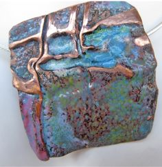 Pendant fold formed enameled copper