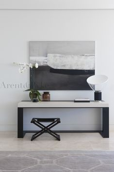 contemporary console with soft pale palette and considered artwork - arentpyke photography by Jason Busch