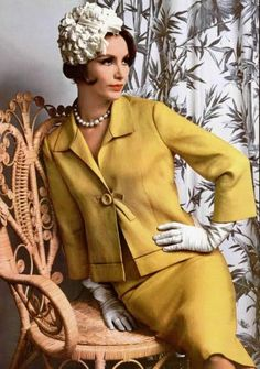 Vintage. 1950's fashion ~ love the suit.. the hat ~ eh... not so much.