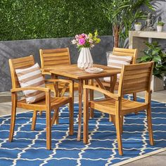 Offer a serene and joyful vibe to your patio with the addition of this magnificently designed Noble House York Teak Brown Wood Outdoor Dining Set. 4 Dining Chairs, Outdoor Dining Set, Outdoor Living Areas, Patio Dining, Dining Table, Outdoor Wood Furniture, Communal Table, Solid Wood Table Tops, 3 Piece Dining Set