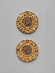 Pair of gold and rock crystal disks, set with garnet and glass inlays Period: Late Archaic Date: early 5th century B.C. Culture: Etruscan...