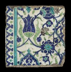 A Damascus underglaze-painted pottery border Tile  Syria, 17th Century with floral arabesques, cobalt tulips and turquoise and cobalt pomegranates, cusped medallions in cobalt-blue and turquoise containing dense arabesque, and border of repeating lobed arches containing florets