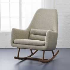 SAIC quantam rocking chair: created exclusively for Design Collab. Sculptural curved catalpa wood legs support cozy poly-blend upholstery in a warm, modern neutral. A welcoming spot for reading, watching tv or a little cat nap. Midcentury Modern, Modern Chairs, Modern Beds, Modern Bedding, Wood Twin Bed, Wood Beds, Design Café, Chair Design, Interior Design