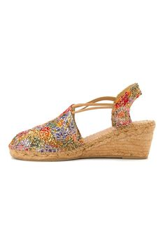 This Toni Pons shimmery, incredibly versatile, timeless, multi-hued upper, closed toe, sling back, braided espadrille wedge adds comfort and a touch of glamour to a casual but elegant outfit. Step into the Toni Pons 'Trento' Espadrille Wedge Sandal and step into true statement fashion.     Heel Height: 2 1/4 inches Platform Height: 1/2 inch   Trento Colorful Espadrille by Toni Pons. Shoes - Flats - Espadrilles Branford, Connecticut