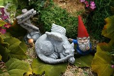 Concrete Gnome & Baby Dragon Statue / 2 Piece Set  Awww! A Gnome and his Dragon -- the perfect friendship. This wee garden gnome comforts his baby
