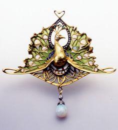 An Art Nouveau opal, diamond, plique-à-jour enamel and gold 'Peacock' brooch, by Lucien Gautrait, 1890s. #Gautrait #ArtNouveau #brooch
