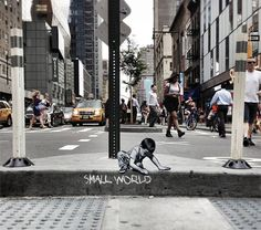 Small World Joe Iurato Main // Life is an adventure for tiny wooden figures navigating the urban world in this miniature art installation series by Joe Iurato.