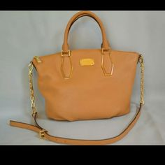 Michael Kors Vanessa Leather Purse NWT!!! Top zip closure, optional adjustable strap, protective metal feet, suntan color, care card included. New and never used MICHAEL Michael Kors Bags Satchels