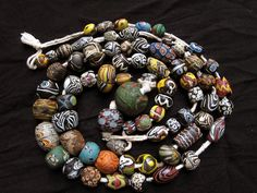 Islamic Beads, Strand of 78 pieces of stunning ancient Islamic glass beads from 7the century
