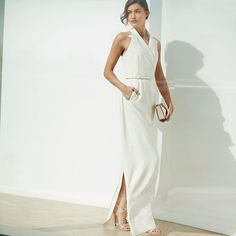 5385faf8dd7 Celebrations call for a special dress. Exceed expectations in this sweeping   MaxMara sleeveless gown
