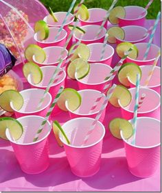 too cute for an outdoor summer party-- pink solo cups, striped straws, lime
