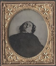 This is a cased 1/6 tintype of an elderly woman. We found a scrap of paper advertising daguerreotype cases behind the tintype. There is faint writing that told us she lived in a village in Pennsylvania.