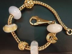 Unique combinations with the gold Trollbeads bracelet!