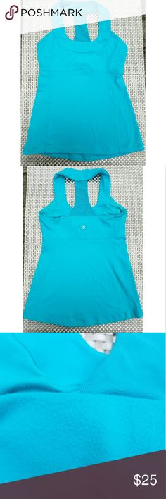 Lululemon Blue Scoop Neck Tank Lululemon Blue Scoop Neck Tank with built in bra top with openings for cup inserts, has some areas of fuzzing.    Size 6 lululemon athletica Tops