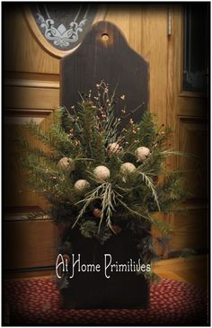 3 feet long colonial door box filled with winter greens and No-melt snowballs by At Home Primitives