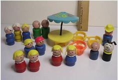 The good Little People were made during the 1950s and 1960s out of wood.  They were so fun to chew on!