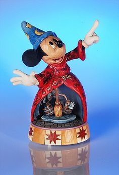 """Heartwood Creek by Jim Shore Disney Traditions  Mickey Mouse Musical Sorcerer's Apprentice    Mickey acts out the most famous scene in Fantasia.  Inside scene rotates  Plays """"The Sorcerer's Apprentice"""" from Walt Disney's Fantasia  7.75""""L x 10.25""""H x 5.5""""W  Resin    Your Price: $75.00"""