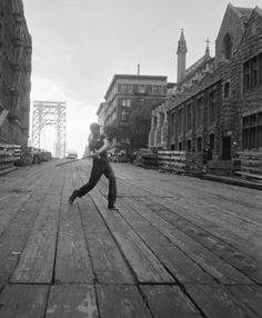 A young boy swinging a baseball bat on a boardwalk in New York. (Photo by Ernst Haas/Ernst Haas/Getty Images) Washington Heights, Usa Cities, Hudson River, George Washington Bridge, Young Boys, Photojournalism, Manhattan, New York City, Louvre