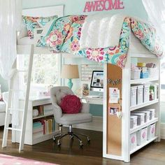 Loft bed with plenty of desk and shelf space.