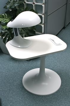 Turnable bed side table with build in colombo dect phone and vintage design lamp.