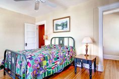 Beautiful antique bed and quilt...so charming with the hardwood floors.