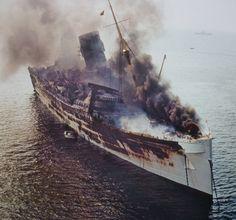SEAWISE UNIVERSITY, ex QUEEN ELIZABETH burning in the port of HongKong Rms Queen Elizabeth, Queen Mary, Hms Hood, Ship Breaking, Abandoned Ships, Merchant Navy, Ghost Ship, Navy Ships, Shipwreck