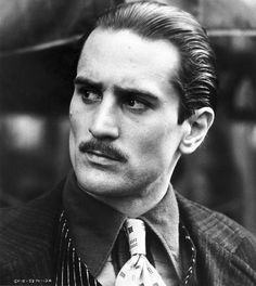 Did you know, that Robert De Niro and Marlon Brando are the only actors to win an Academy Award for playing the same role? The role was Don Vito Corleone in Francis Ford Coppola's The Godfather, in. The Godfather Part Ii, Godfather Movie, Godfather Actors, Al Pacino, Marlon Brando, Looks Black, Black And White, Benecio Del Toro, Chicano Art