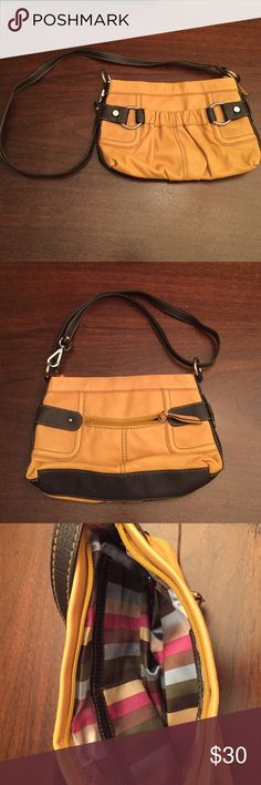 Tignanello crossbody/over-the-shoulder Can be converted from a cross body to an over the shoulder bag. Medium sized. Two exterior pockets -one zip and one elastic. Three pockets within the main compartment- 1 large zipped and 2 open. Great colors for summer and fall! Barely used, like new! Tignanello Bags Crossbody Bags