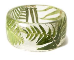 Sarah Smith creates hand-made bracelets, bangles and earrings by forever preserving beautiful bits and pieces of nature in hard, crystal-clear resin.