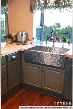 The Heritage Farmhouse Sink in Brushed Hammered Stainless looks stunning in this cozy country kitchen. Did you notice that incredible view from the kitchen window? So much greenery 💛🌳 #greencabinets #moderncottage #rusticfarmhouse #interiorlife #homedesigntrends #homeimprovement Stainless Steel Farmhouse Sink, Stainless Steel Cleaner, Stainless Kitchen, Stainless Steel Types, Stainless Steel Sinks, Brushed Stainless Steel, Farmhouse Aprons, Farmhouse Sinks, Copper Sinks