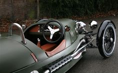 The coolest car you'll ever see. Morgan 3 wheeler complete with WWII graphics and period leather. Want.