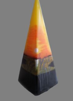 Stunning sunset pyramid candle hand painted.